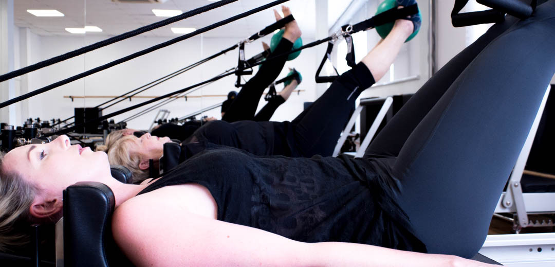 Which Pilates Class is Right For Me? We're Taking You Back to School!